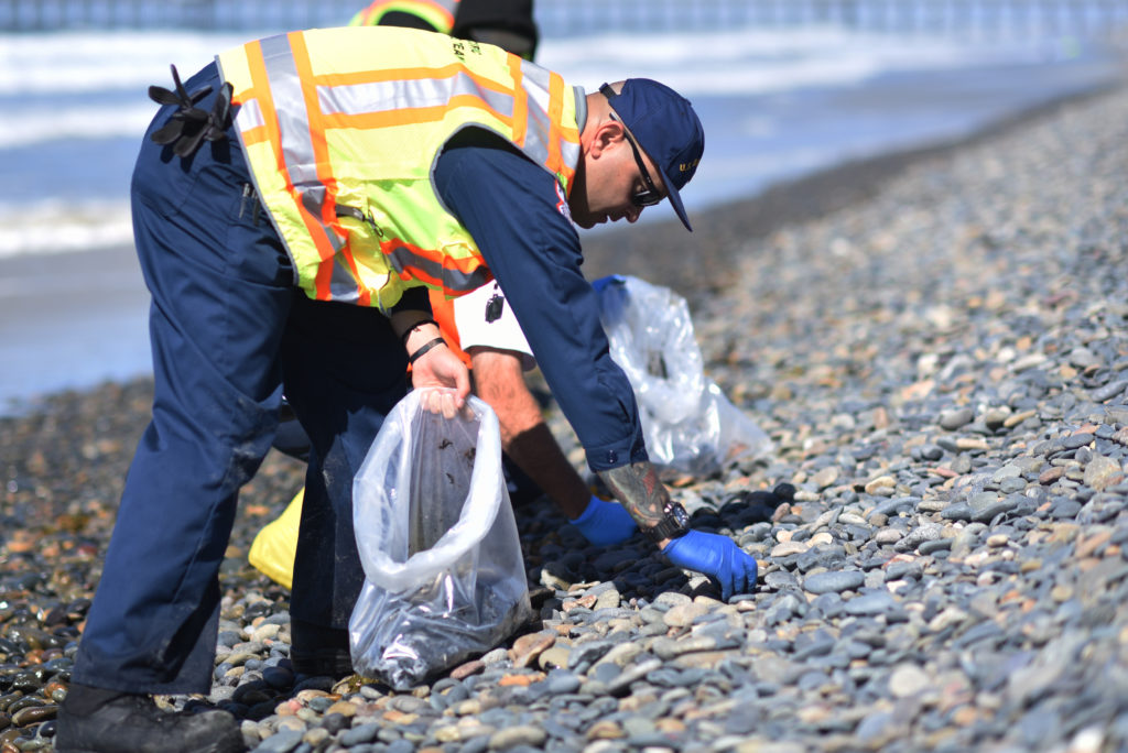 Tar balls being removed from shores in Oceanside Harbor Beach in San Diego County