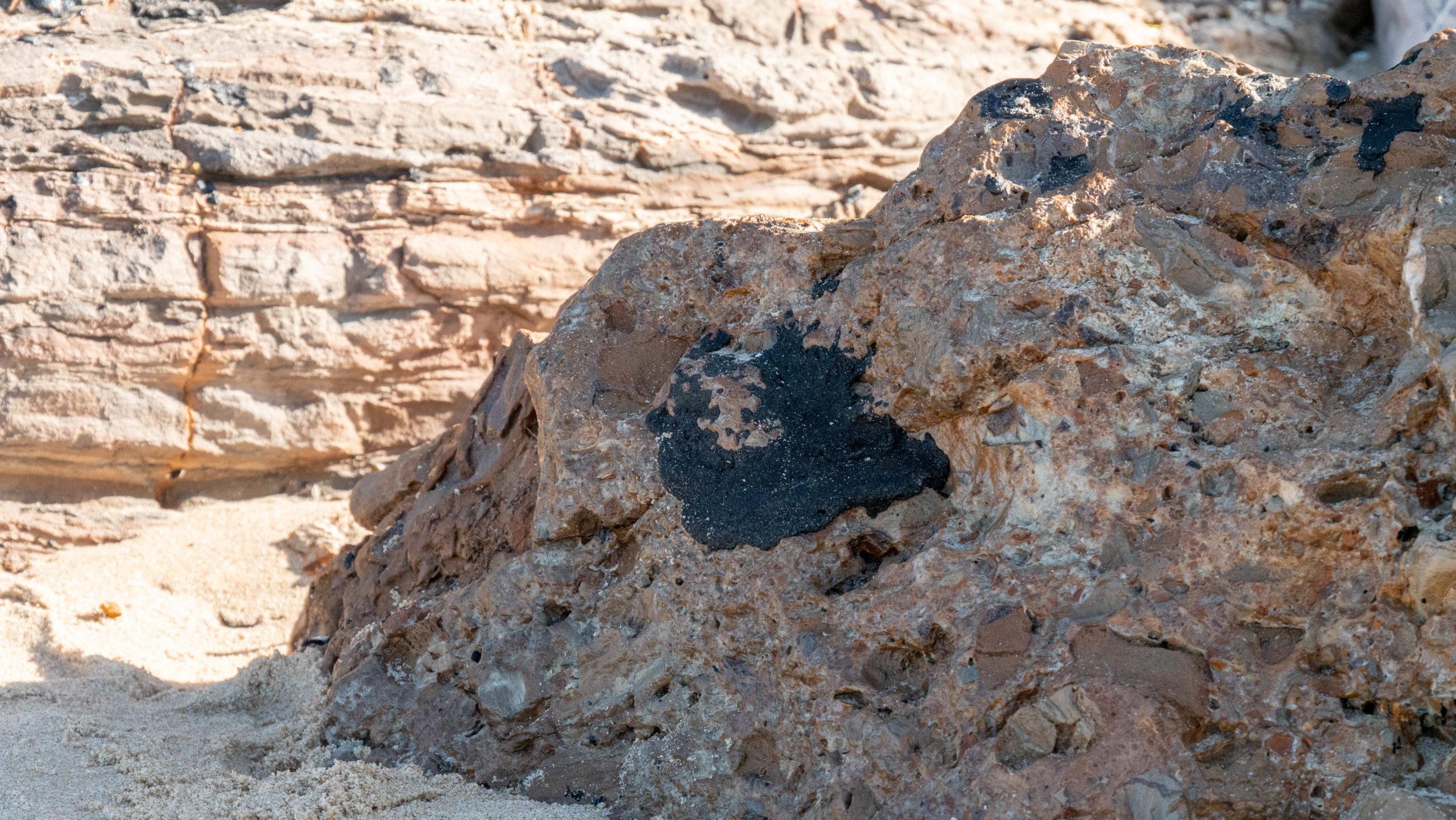 Oil is seen on rocks